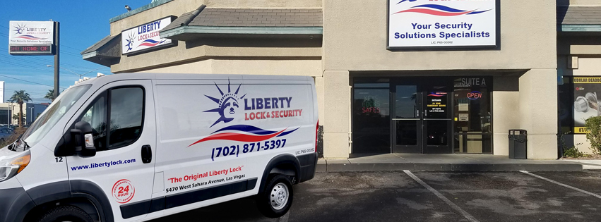 A Liberty Lock and Security service van in front of the store